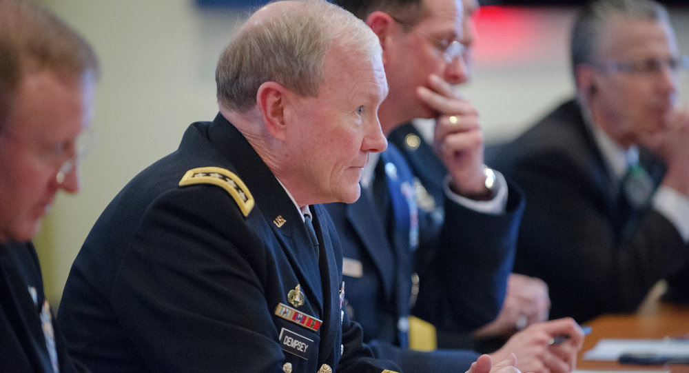 US Army Gen. Martin E. Dempsey, chairman of the Joint Chiefs of Staff, speaks with his Russian counterpart during a NATO meeting for defense chiefs in Brussels, January 21, 2014