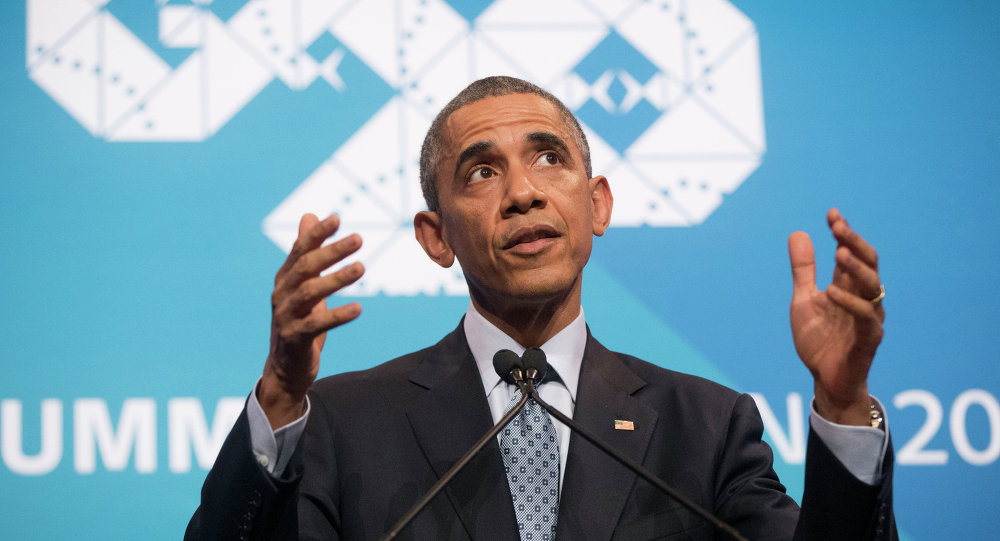 US  President Barack Obama gestures as he answers questions during his news conference at the G20 Summit in Brisbane, Australia, Sunday, Nov. 16, 2014
