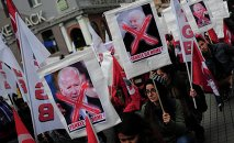 Left wing demonstrators hold anti-U.S. banners during a protest against the visit of U.S. Vice President Joe Biden, in central Istanbul November 22, 2014