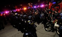 Police officers block a Highway 580 off ramp during a demonstration following the grand jury decision in the Ferguson, Missouri shooting of Michael Brown, in Oakland, California