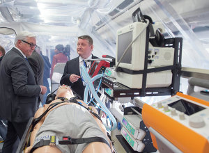 German Foreign Minister Frank-Walter Steinmeier and Health Minister Hermann Groehe, from left, inspect the medevac plane Robert Koch for Ebola patients