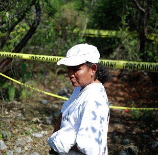A woman with missing relatives in Mexico.
