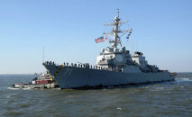 A US warship and military planes almost collided with the Iranian Navy while patrolling waters in the Gulf of Aden.
