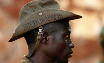 "PICTURES OF THE YEAR 2014 A Seleka fighter wears a hat that reads ""Bocou Harame"", in a reference to the Islamist militant group Boko Haram, in the town of Bria, in this April 9, 2014 file photo"