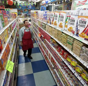 In this photo taken Thursday, Nov. 1, 2012, Grocery market owner Ray Martinez poses for a photo at La Playa Market in Inglewood, Calif