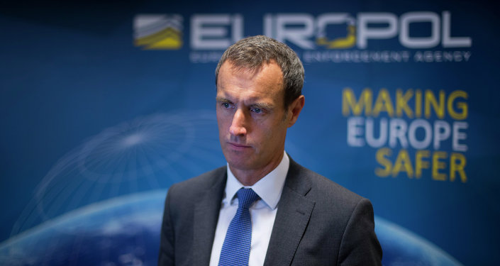 The head of the European police agency Europol, Rob Wainwright, right, answers questions during an interview in The Hague, Netherlands, Friday, Jan. 16, 2015.