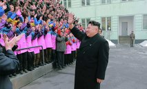North Korean leader Kim Jong Un waves to a crowd as he provides field guidance to the Ryuwon Shoes Factory in this undated photo released by North Korea's Korean Central News Agency (KCNA) in Pyongyang January 21, 2015