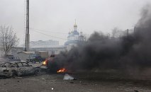 A car burns on the street after a shelling by pro-Russian rebels of a residential sector of Mariupol, eastern Ukraine, January 24, 2015