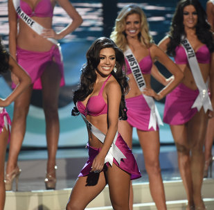 Miss Philippines Mary Jean Lastimosa (C) and other contestants participtate in the swim suit competition during the 63rd Annual MISS UNIVERSE Pageant at Florida International University on January 25, 2015 in Miami, Florida