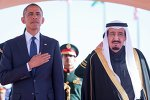 US President Barack Obama stands with Saudi Arabia's King Salman (R) after arriving in Riyadh January 27, 2015.