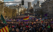 People wave Republican and Podemos party flags during a Podemos (We Can) party march in Madrid, Spain, Saturday, Jan. 31, 2015