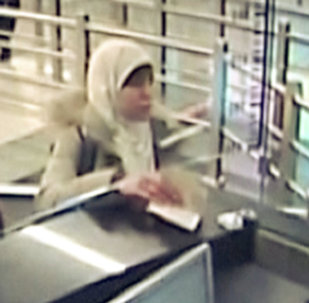 Hayat Boumeddiene, the suspected female accomplice of the Islamist militants behind the attacks in Paris, is seen upon her arrival to Turkey in this still image taken from surveillance video at Sabiha Gokcen airport in Istanbul on January 2, 2015.