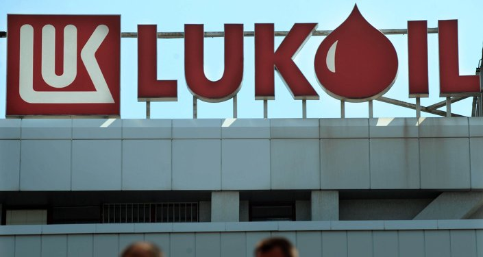 People walks in front of the Lukoil Neftochim Headquarters in Sofia on July 27, 2011