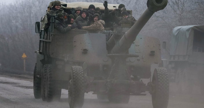 Members of the Ukrainian armed forces ride on a military vehicle near Artemivsk, eastern Ukraine February 14, 2015