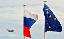 Flags of Russia, EU, France and coat of arms of Nice on the city's promenade