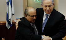 In this 2011 photo, Israel Prime Minister Benjamin Netanyahu hugs Meir Dagan, the then-director of Israel spy agency Mossad.