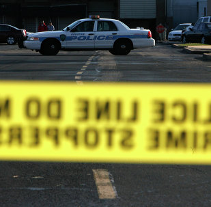 In this 2008 file photo, police taped off a portion of a parking lot behind Sharpstown Mall in Houston.