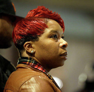 Lesley McSpadden, the mother of Michael Brown, prepares to speak to a crowd of supporters, Friday, Dec. 5, 2014, in Jefferson City, Mo