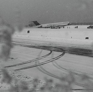 A Delta jet which skidded off the runway at Laguardia airport is attended by emergency personnel in New York City March 5, 2015