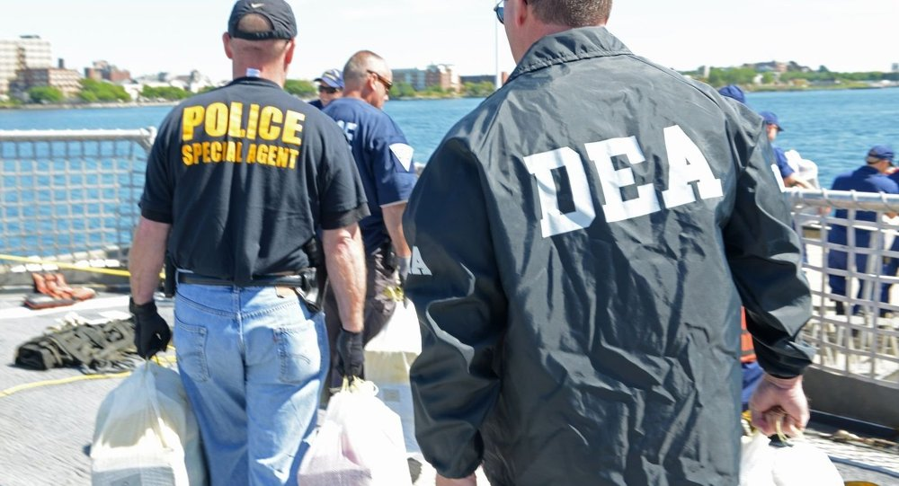 dea agent Chicago — a federal agent fatally shot a drug suspect in chicago on saturday, officials said according to the drug enforcement administration, the agent.