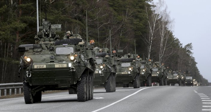 Soldiers of the US Army 2nd Cavalry Regiment deployed in Estonia as a part of the US military's Operation Atlantic Resolve, arrive during the Dragoon Ride exercise in Liepupe March 22, 2015