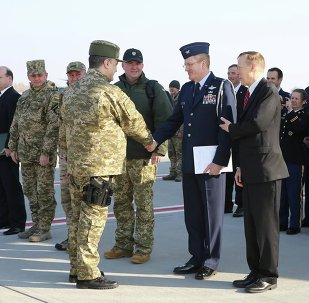 Ukraine's President Petro Poroshenko (L) during a welcome ceremony for first plane from United State with non-lethal aid including ten Humvee vehicles to Ukraine at Borispol airport near Kiev