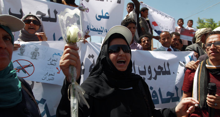 A Yemeni woman shouts slogans during a rally against Saudi-led coalition airstrikes against Huthi rebels on March 29, 2015 in Sanaa
