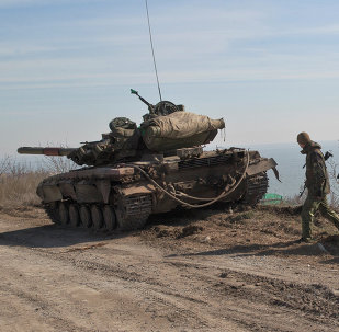 Ukraine government forces stand by a tank on a front line position east of the Sea of Azov port city, Mariupol, Ukraine