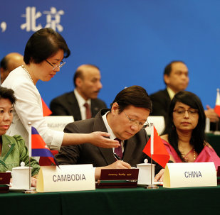 Chinese Finance Minister Lou Jiwei (C) signs with guests at the signing ceremony of the Asian Infrastructure Investment Bank at the Great Hall of the People in Beijing