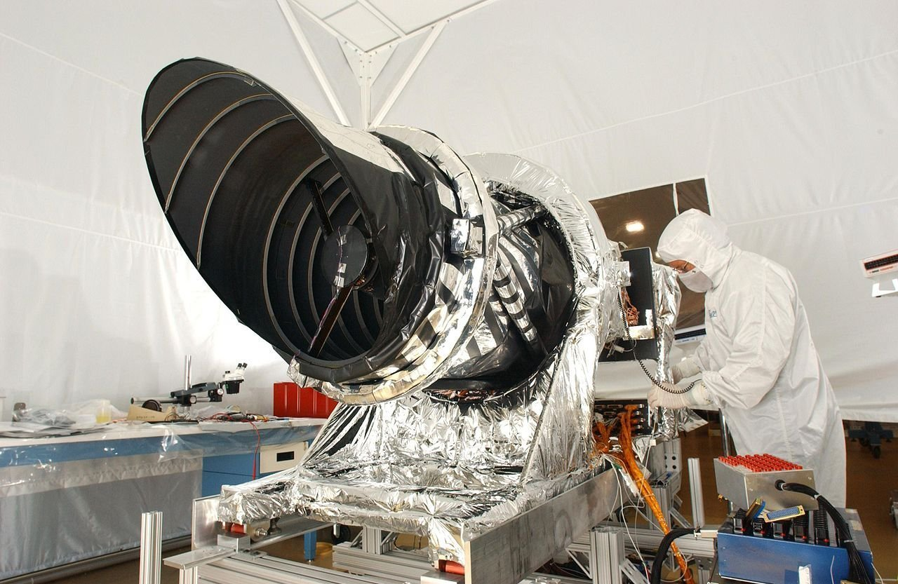 The HiRISE, which has collected enough data for researchers to make determinations on the amount of ice within Mars, being prepared to be attached to a spacecraft.