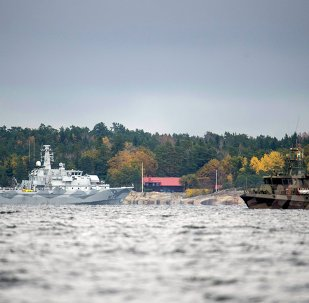 The Swedish minesweeper HMS Kullen, left, and a guard boat in Namdo Bay, Sweden,Tuesday, Oct. 21, 2014 on their fifth day of searching for a suspected foreign vessel in the Stockholm archipelago