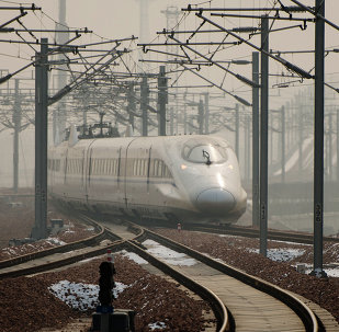 A high-speed train departs a platform in Hebei province south of Beijing on December 22, 2012