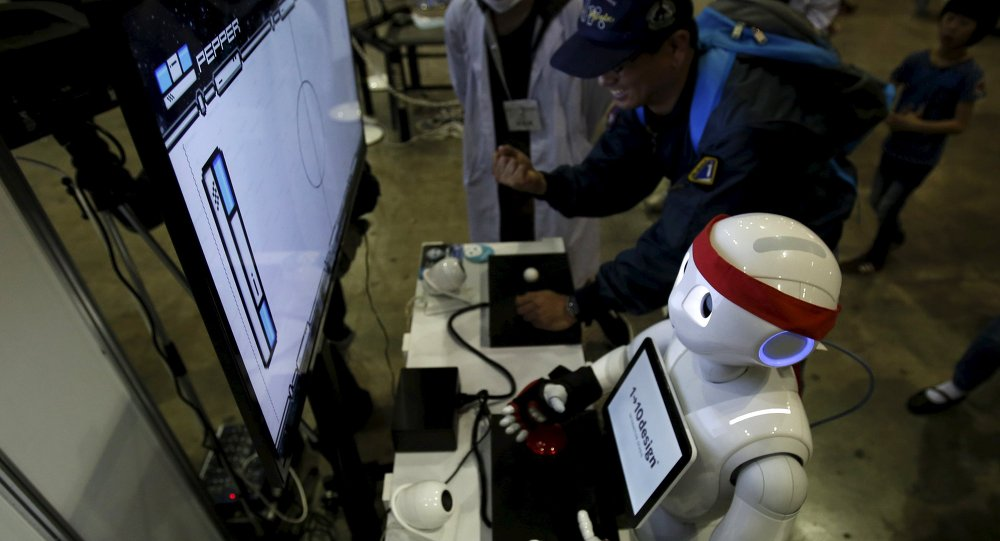 SoftBank Corp's humanoid robot named Pepper plays a video game against a visitor at a booth during Niconico Chokaigi 2015 in Makuhari, east of Tokyo, Japan April 26, 2015.