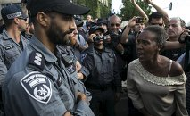 A protester, who is an Israeli Jews of Ethiopian origin, shouts at a policeman during a demonstration against what they say is police racism