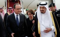 French President Francois Hollande, left, is greeted by Saudi Arabia's King Salman upon his arrival at Riyadh airport, Saudi Arabia, Monday, May 4, 2015