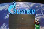 An employee assembles parts at the booth of Russian company Gazprom in preparation of the Hanover industrial fair in Hanover, Germany