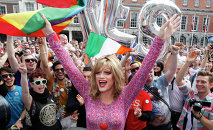 Rory O'Neill, known by the Drag persona Panti, celebrates with yes supporters at Dublin Castle, Ireland, Saturday, May 23, 2015. Ireland has voted resoundingly to legalize gay marriage in the world's first national vote on the issue, leaders on both sides of the Irish referendum declared Saturday even as official ballot counting continued. Senior figures from the no campaign, who sought to prevent Ireland's constitution from being amended to permit same-sex marriages, say the only question is how large the yes side's margin of victory will be from Friday's vote.