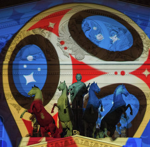 The official emblem of 2018 FIFA World Cup Russia projected on the facade of the State Academic Bolshoi Theatre, Moscow