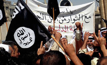 Demonstrators chant pro-al-Qaida-inspired Islamic State of Iraq and the Levant (ISIL) as they wave al-Qaida flags in front of the provincial government headquarters in Mosul. File photo