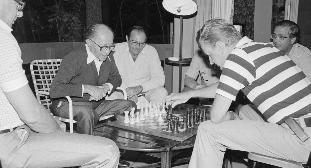 Menahem Begin and Zbigniew Brzezinski play chess during the Camp David Summit