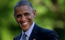 President Barack Obama smiles as he walks across the South Lawn to the White House from Marine One, Wednesday, May 20, 2015, in Washington