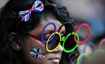 A spectator at the closing ceremony of the 30th Summer Olympic Games in London's Olympic Stadium.