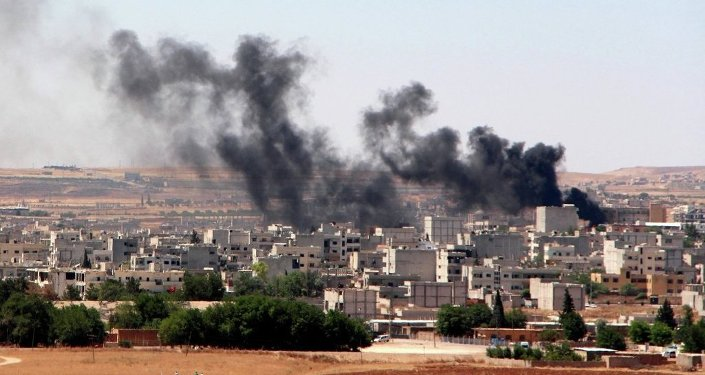 Smoke billow from the Syrian town of Kobane, as seen from the Turkish side of the border in Suruc in Sanliurfa province on June 25, 2015. Turkey denied baseless claims that Islamic State (IS) militants reentered the Syrian town of Kobane through the Turkish border crossing to detonate a suicide bomb,