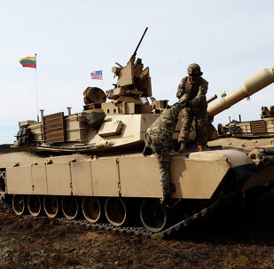 U.S. soldiers from the 2nd Battalion, 1st Brigade Combat Team, 3rd Infantry Division at the M1A2 Abrams battle tank during a military exercise at the Gaiziunu Training Range in Pabrade some 60km.(38 miles) north of the capital Vilnius, Lithuania, Thursday, April 9, 2015