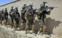 In this Thursday, April 12, 2012 file photo, Afghan special forces demonstrate a raid for rescuing a hostage during a showing at the commando training center in Kabul, Afghanistan.
