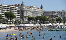 People swim in the Mediterranean Sea in the French southeastern city of Cannes on July 31, 2013