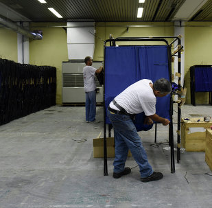Municipality workers prepare the equipment for the upcoming referendum at a warehouse in the northern Greek port city of Thessaloniki, Wednesday, July 1, 2015