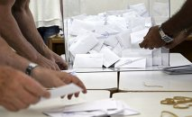 Voting officials count ballots