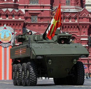Bumerang armored personnel carrier drives during the Victory Parade marking the 70th anniversary of the defeat of the Nazis in World War II, in Red Square in Moscow, Russia, Saturday, May 9, 2015