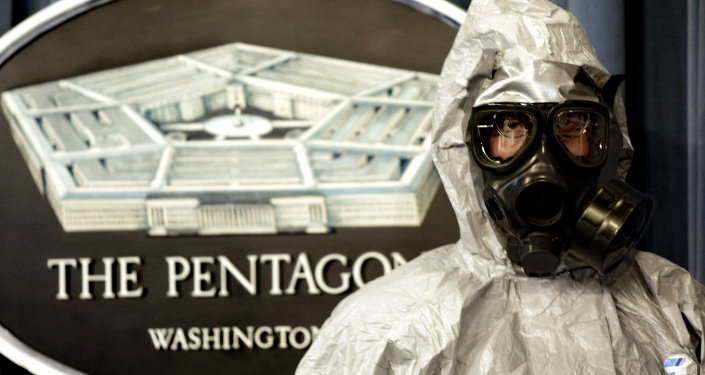 A member of the US Army Technical Escort Unit (TSU) demonstrates a hazmat suit as they show some of their response capabilities to chemical and biologicial operations in support of the US Department of Defense, federal, state, and local agencies 12 November 2002
